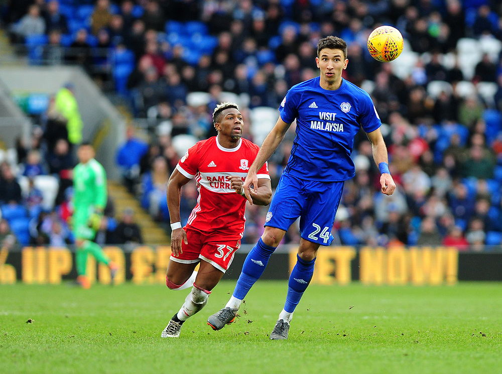 Middlesbrough's Adama Traore vies for possession with Cardiff City's Marko Grujic<br /> <br /> Photographer Ashley Crowden/CameraSport<br /> <br /> The EFL Sky Bet Championship - Cardiff City v Middlesbrough - Saturday 17th February 2018 - Cardiff City Stadium - Cardiff<br /> <br /> World Copyright © 2018 CameraSport. All rights reserved. 43 Linden Ave. Countesthorpe. Leicester. England. LE8 5PG - Tel: +44 (0) 116 277 4147 - admin@camerasport.com - www.camerasport.com