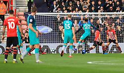 Tottenham Hotspur's Dele Alli (centre right) shoots wide of the goal