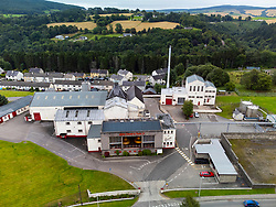 Aerial view from drone of John Dewar and Sons scotch whisky distillery at Craigellachie on River Spey, Speyside, Moray, Scotland, UK