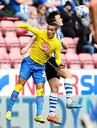 Tom Ince of Derby County wins a header against William Kvist of Wigan Athletic  - Photo mandatory by-line: Matt McNulty/JMP - Mobile: 07966 386802 - 06/04/2015 - SPORT - Football - Wigan - DW Stadium - Wigan Athletic v Derby County - SkyBet Championship