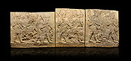 Hittite sculpted orthostats panels of Long Wall Limestone, Karkamıs, (Kargamıs), Carchemish (Karkemish), 900-700 B.C. Soldiers. Anatolian Civilisations Museum, Ankara, Turkey<br /> <br /> Figures of helmeted warriors. They have their shield in their back and their spear in their hand. The prisoner in their front is depicted as small. The lower part of the orthostat is decorated with braiding motifs. <br /> <br /> On a black background. .<br />  <br /> If you prefer to buy from our ALAMY STOCK LIBRARY page at https://www.alamy.com/portfolio/paul-williams-funkystock/hittite-art-antiquities.html  - Type  Karkamıs in LOWER SEARCH WITHIN GALLERY box. Refine search by adding background colour, place, museum etc.<br /> <br /> Visit our HITTITE PHOTO COLLECTIONS for more photos to download or buy as wall art prints https://funkystock.photoshelter.com/gallery-collection/The-Hittites-Art-Artefacts-Antiquities-Historic-Sites-Pictures-Images-of/C0000NUBSMhSc3Oo