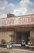 A porter sits outside the railway station in Mombasa, Kenya
