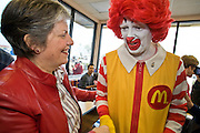 27 NOVEMBER 2008 -- PHOENIX, AZ: Arizona Governor Janet Napolitano talks to Ronald McDonald during a Thanksgiving breakfast at a McDonald's restaurant in Phoenix, AZ. Napolitano, an early supporter of then Illinois Senator now President Elect Barack Obama, has been widely rumored to be Obama's choice for Secretary of the United States Department of Homeland Security. Napolitano, a Democrat, was the US Attorney for Arizona during the Clinton Administration, elected to Arizona Attorney General and, in 2002, elected Governor of Arizona. She was reelected in 2006. She has been a strong supporter of increased border enforcement.  Photo by Jack Kurtz / ZUMA Press