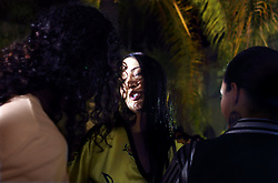 Noor, a transexual dancer, chats with friends during a party following one of the FestiMode fashion shows in Casablanca, Morocco on May 8, 2009.