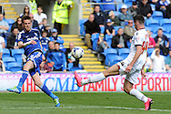 Cardiff City's Craig Noone (l) volleys at goal as Bolton's Tyler Garratt tries to block it. Skybet football league championship match, Cardiff city v Bolton Wanderers at the Cardiff city Stadium in Cardiff, South Wales on Saturday 23rd April 2016.<br /> pic by Carl Robertson, Andrew Orchard sports photography.