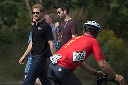 Prince Harry watches a competitor go past as he attends the Invictus Games cycling event in Toronto, ON, Canada, on Tuesday September 26, 2017. Photo by Chris Young/CP/ABACAPRESS.COM