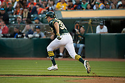 Oakland Athletics center fielder Jaycob Brugman (38) runs to first base after making contact with a pitch against the San Francisco Giants at Oakland Coliseum in Oakland, California, on July 31, 2017. (Stan Olszewski/Special to S.F. Examiner)