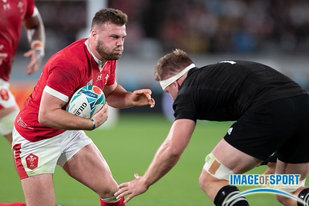 Owen Lane of Wales runs with the ball during the Rugby World Cup bronze final match between New Zealand and Wales, Friday, Nov, 1, 2019, in Tokyo. New Zealand defeated Wales 40-17. ( Flor Tan Jun/Espa-Images-Image of Sport)