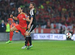 Nicolas Lombaerts of Belgium (Zenit Saint Petersburg) fouls Gareth Bale of Wales (Real Madrid) - Photo mandatory by-line: Alex James/JMP - Mobile: 07966 386802 - 12/06/2015 - SPORT - Football - Cardiff - Cardiff City Stadium - Wales v Belgium - Euro 2016 qualifier