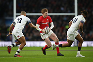 Rhys Patchell of Wales © looks to go past England's Jonathan Joseph and Anthony Watson ®.  England v Wales, NatWest 6 nations 2018 championship match at Twickenham Stadium in Middlesex, England on Saturday 10th February 2018.<br /> pic by Andrew Orchard, Andrew Orchard sports photography