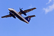 20 FEBRUARY 2009 -- PHOENIX, AZ: A US Airways Express Bombardier Aerospace Dash 8 takes off from Sky Harbor Airport in Phoenix. The plane is made in Canada by Bombardier and widely used as a commercial passenger plane on short haul flights.  PHOTO BY JACK KURTZ