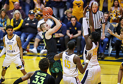 Jan 21, 2019; Morgantown, WV, USA; Baylor Bears guard Makai Mason (10) shoots in the lane during the first half against the West Virginia Mountaineers at WVU Coliseum. Mandatory Credit: Ben Queen-USA TODAY Sports
