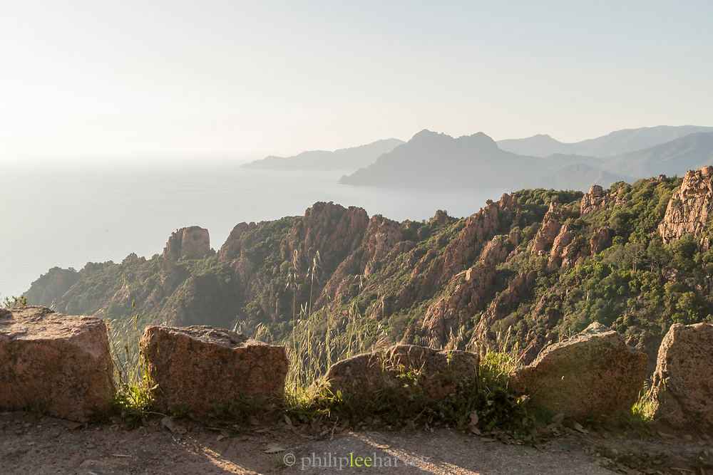 View of high, extreme mountains and rocks on road, Calanches de Piana, Corsica, France