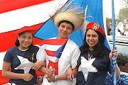 Performers age 17 with Puerto Rican flag at Cinco de Mayo.  St Paul Minnesota USA