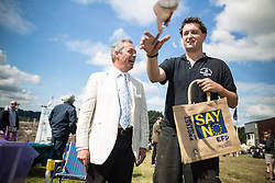 © Licensed to London News Pictures. 31/07/2015. Leeds , UK . NIGEL FARAGE signs autographs at the CLA GameFair ( Country Landowners Association ) at Harewood House in Yorkshire . Photo credit: Joel Goodman/LNP