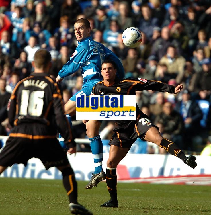 Photo: Ed Godden.<br />Reading v Wolverhampton Wanderers. Coca Cola Championship. 18/03/2006.<br />Reading's Ivar Ingimarsson (centre) rises high to win the ball.
