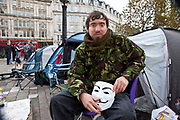 Tristan Woods from Basingstoke demonstrating at Occupy London OSLX, St Pauls Catherdral, London.