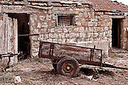 Old barn, cart and  courtyard, Zikhron Ya'aqov Israel, Zihron Yaaqov; also Zichron Yaakov (meaning Jacob's memorial) was established 1882 on Mount Carmel, by pioneers from Romania, members of Hovevei Zion movement. In 1883 Baron Edmond James de Rothschild became the patron of the new settlement. The place was named in memory of his father, James (Jacob) Mayer de Rothschild. In 1885 Rothschild helped to establish the first winery in the country in Zikhron Ya'aqov.