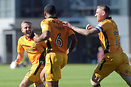 Joss Labadie of Newport county celebrates with teammates Daniel Butler (l) and Scott Bennett (r)  after he scores his teams 2nd goal to equalise at 2-2.  Skybet EFL league two match, Newport county v Mansfield Town at Rodney Parade in Newport, South Wales on Saturday 6th August 2016.<br /> pic by Carl Robertson, Andrew Orchard sports photography.