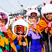 Kids dress up in costumes on their last day of winter sports school at Jackson Hole Mountain Resort with the Gondola in the background.