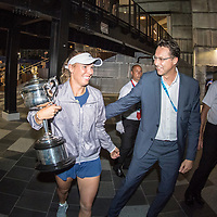 Caroline Wozniacki of Denmark with Rolex staff after winning the women's singles championship match during the 2018 Australian Open on day 13 in Melbourne, Australia on Saturday afternoon January 27, 2018.<br /> (Ben Solomon/Tennis Australia)