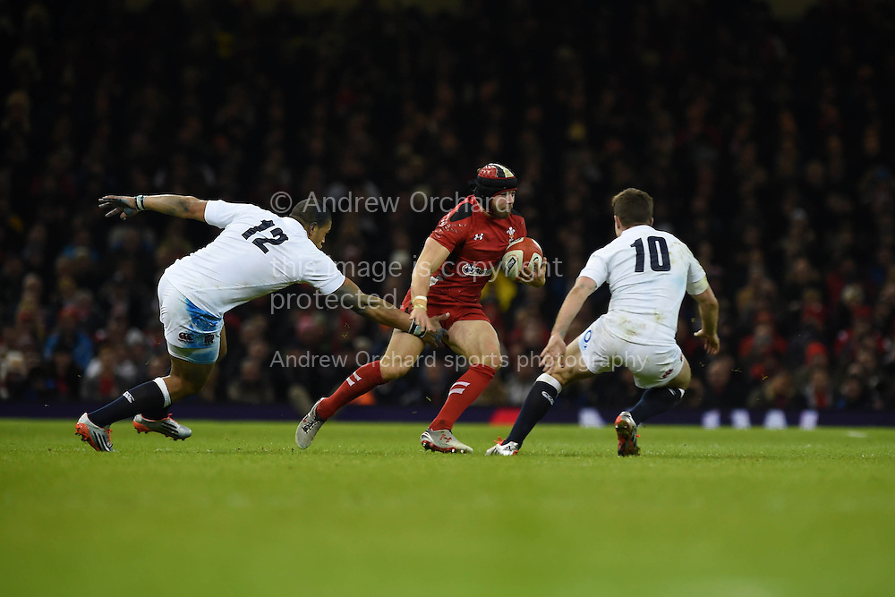 Leigh Halfpenny of Wales © looks to go past George Ford of England ®and  Luther Burrell. RBS Six nations championship 2015, Wales v England at the Millennium Stadium in Cardiff, South Wales on Friday 6th  Feb 2015. pic by Andrew Orchard, Andrew Orchard sports photography.