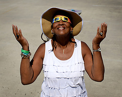 August 21, 2017 - Charlotte, North Carolina, U.S. - AYANA MORELAND of Charlotte, N.C. basks in the solar eclipse from the rooftop of the Discovery Place parking deck on Monday. (Credit Image: © Jeff Siner/TNS via ZUMA Wire)