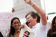 BIRMINGHAM, AL –SEPTEMBER 16, 2012: Maria Vuelta, an Undocubus rider, speaks to dozens of undocumented Hispanic demonstrators outside Sheraton Hotel in Birmingham, Alabama, during a briefing on the civil rights effects of state immigration law held by the U.S. Commission on Civil Rights in Birmingham, Alabama on August 17, 2012.