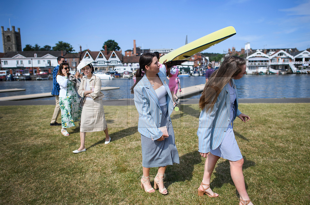 © Licensed to London News Pictures. 04/07/2018. Henley-on-Thames, UK. A group of women duck to avoid being hit by a boat on  day one of the Henley Royal Regatta, set on the River Thames by the town of Henley-on-Thames in England. Established in 1839, the five day international rowing event, raced over a course of 2,112 meters (1 mile 550 yards), is considered an important part of the English social season. Photo credit: Ben Cawthra/LNP