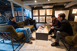 Harley-Davidson's (L>R) Charlie Wartgow, head of design Ray Drea, Dais Nagao and Ben McGinley at the Deus Ex Machina new Tokyo store 3-days after its grand opening. Tokyo. Japan. Wednesday, December 10, 2014. Photograph ©2014 Michael Lichter.