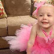 Holly Larue Frizzelle, 2 poses for a portrait in a tutu that was donated to her by Tutu Divine of Southport, N.C.