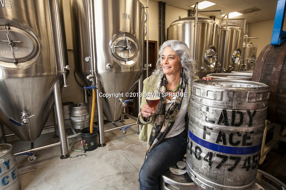 Cyrena Nouzille, owner of LadyFace Ale Companie in Agoura Hills, CA. poses with one of her brews in the brewing area. Shot Feb. 5th,  2013 Photo by David Sprague ©2013