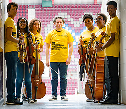 Edinburgh, Scotland, United Kingdom, 2 August 2019. Edinburgh Festival Fringe: Photocall prior to this evening's Edinburgh International Festival Aberdeen Standard Investments Opening Event: LA Phil at Tynecastle with conductor Gustavo Dudamel and members of the Youth Orchestra of Los Angeles ahead of the Aberdeen Standard Investments Opening Event: LA Phil at Tynecastle stadium, home to Hearts football club.<br /> Credit: Sally Anderson/Alamy Live News