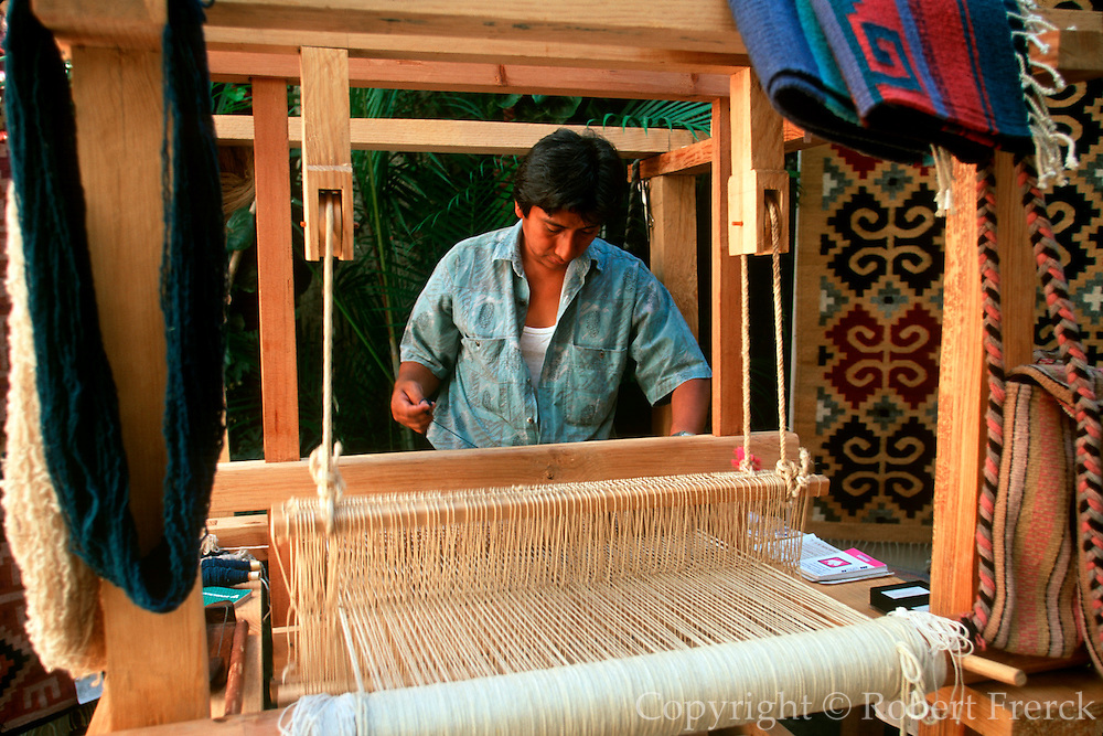 MEXICO, OAXACA, OAXACA STATE Oaxaca craftsman producing hand made woven rugs on a traditional loom