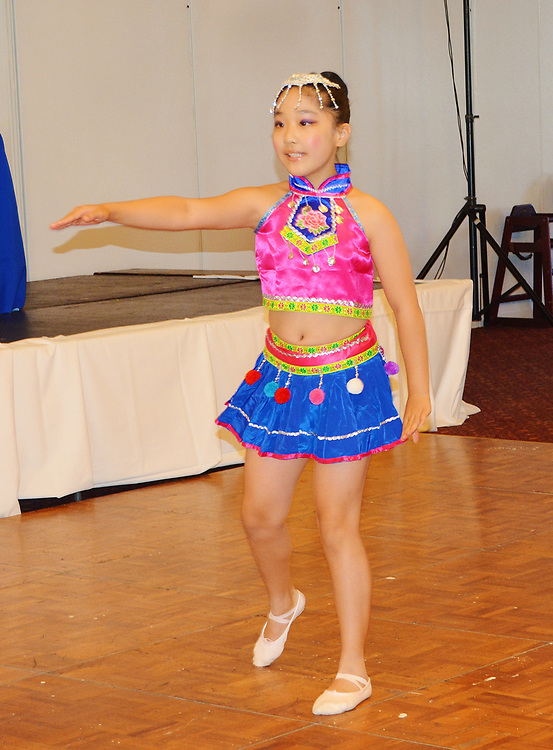 Poe ES student performs a traditional Chinese dance.