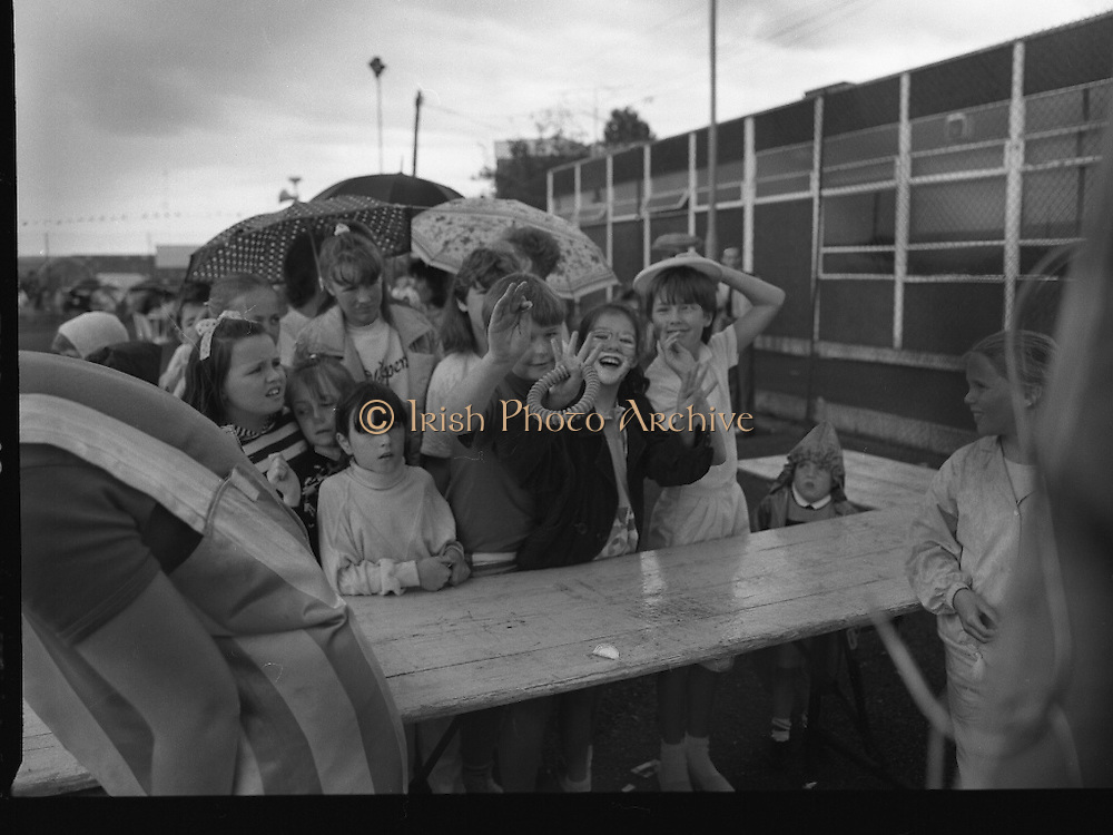 """Guinness Family Day At The Iveagh Gardens. (R83)..1988..02.07.1988..07.02.1988..2nd  July 1988..The family fun day for Guinness employees and their families took place at the Iveagh Gardens today. Top at the bill at the event were """"The Dubliners"""" who treated the crowd to a performance of all their hits. Ireland's penalty hero from Euro 88, Packie Bonner, was on hand to sign autographs for the fans...The children are pictured lining up to take part in the ring tossing competition"""