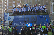 Brighton players lift trophy on open top bus during the Brighton & Hove Albion Football Club Promotion Parade at Brighton Seafront, Brighton, United Kingdom on 14 May 2017. Photo by Phil Duncan.