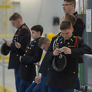 JROTC 1st Lieutenant Kristopher Collins of Tolsia High School waits with other cadets for during the state Junior Reserve Officer Training Corps drill competition at McLaughlin Air National Guard Base in Charleston, W.V., on January 27, 2018. Numerous high schools from around the state participated in the competition which judged <br /> their abilities to execute specific drill movements and tasks.