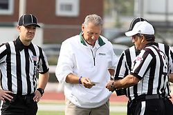 12 October 2013:  Coach Norm Eash speaks with Referee Dave Wallace and Back Judge Phil Kaufman.  Eash became Illinois Wesleyans winningest coach at 169 wins passing a record set by Don Larson after the conclusion of this NCAA division 3 football game between the North Park vikings and the Illinois Wesleyan Titans in Tucci Stadium on Wilder Field, Bloomington IL