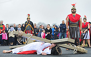 Roberto Marquez, of Bensalem, Pennsylvania portrays Jesus as he falls for the third time during the Stations of the Cross leading to his crucifixion on Good Friday April 3, 2015 at Our Lady of Fatima in Bensalem, Pennsylvania.  (Photo by William Thomas Cain/Cain Images)