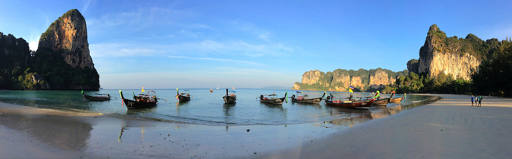 Railay panorama is accessible only by boat as limestone cliffs shut off access from the roads. Nearby cliffs attract rock climbers from around the world. The peninsula is popular because of its pristine, clear water beaches. West side beaches of Railay are connected to the east via trails through the jungle.  The beach, framed by high limestone cliffs, is among the best in Thailand and Southeast Asia.