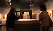 Looking at the work of El Grecco in the Bernaki Museum in Athens, Greece.  Photograph by Dennis Brack