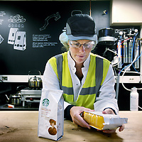 Nederland, Amsterdam , 16 maart 2012..Starbucks Roasting Plant in Amsterdam..Op de foto 1 van de weinige Nederlandse werknemers van Starbucks Roasting Plant, Liesbeth Geels.. .Starbucks Roasting Plant in Amsterdam. One of the few Dutch employees of this company.