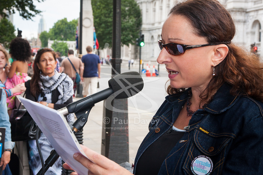 , August 4th 2014. Third generation British Jew Sonya Levine renounces her Israeli citizenship before she burns her Israeli passport  to show her disgust at their ongoing attacks against  Gaza.