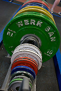Barbell weights at the Sports Institute, University of Ulster, Northern Ireland. The detail view of the discs are seen as they are stacked tidily in a rack on the ground of the gym. Starting from the smallest weight up to the largest of 10kg (kilos), the lifter can choose the relevant weight for the exercise. Sports Institute Northern Ireland (SINI) was set up in 2002 as the catalyst for establishing the high performance sporting system in Northern Ireland. SINI is designed to provide high level support to Northern Ireland's top athletes and coaches across a range of Olympic, Paralympic and Commonwealth Games sports along with a select number of sports that are important to the public in Northern Ireland including rugby, soccer, cricket, GAA, golf and motor sports.