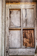 Boarded up doorway in a back alley along the railroad tracks in Portland, OR