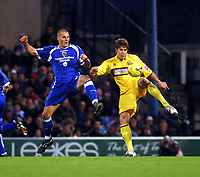 Photo: Dave Linney.<br />Cardiff City v Burnley. Coca Cola Championship. 11/11/2006.Cardiff's  Darren Purse(L) beats  Michael Duff<br />to the ball.