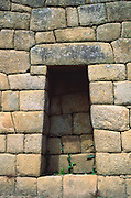 """The Incas finely crafted this stone alcove in a wall at Machu Picchu, a magnificent archeological site in the Cordillera Vilcabamba, Andes mountains, Peru, South America. Machu Picchu was built around 1450 AD as an estate for the Inca emperor Pachacuti (14381472). Spaniards passed in the river valley below but never discovered Machu Picchu during their conquest of the Incas 1532-1572. The outside world was unaware of the """"Lost City of the Incas"""" until revealed by American historian Hiram Bingham in 1911. Machu Picchu perches at 2430 meters elevation (7970 feet) on a well defended ridge 450 meters (1480 ft) above a loop of the Urubamba/Vilcanota River ( Sacred Valley of the Incas). UNESCO honored the Historic Sanctuary of Machu Picchu on the World Heritage List in 1983."""