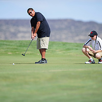 010110       Adron Gardner/Independent<br /> <br /> Gallup Bengal Charleston White, left, putts as Grants Pirate J.T. Goodart looks on during the district golf tournament at the Coyote Del Malpais Golf Course in Grants Monday.