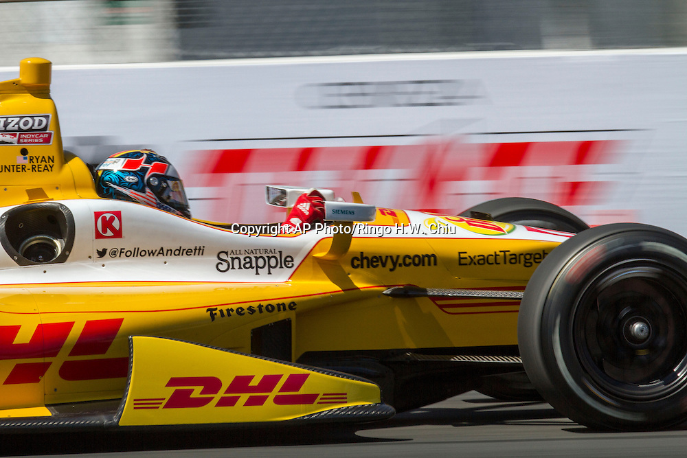 Ryan Hunter-Reay races during the IndyCar qualifying at the 39th Annual Toyota Grand Prix of Long Beach auto race Saturday, April 20, 2013, in Long Beach, Calif.  Hunter-Reay won the 2nd pole for the IndyCar series. Hunter-Reay won the  (AP Photo/Ringo H.W. Chiu)..